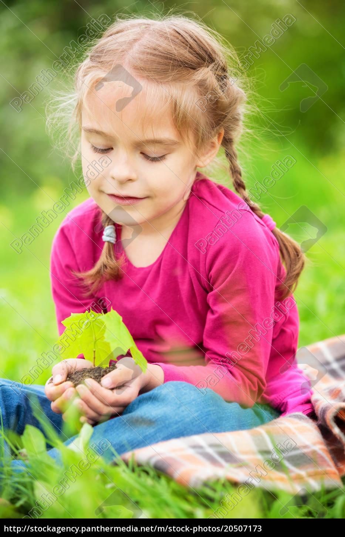little, girl, holding, little, green, plant - 20507173