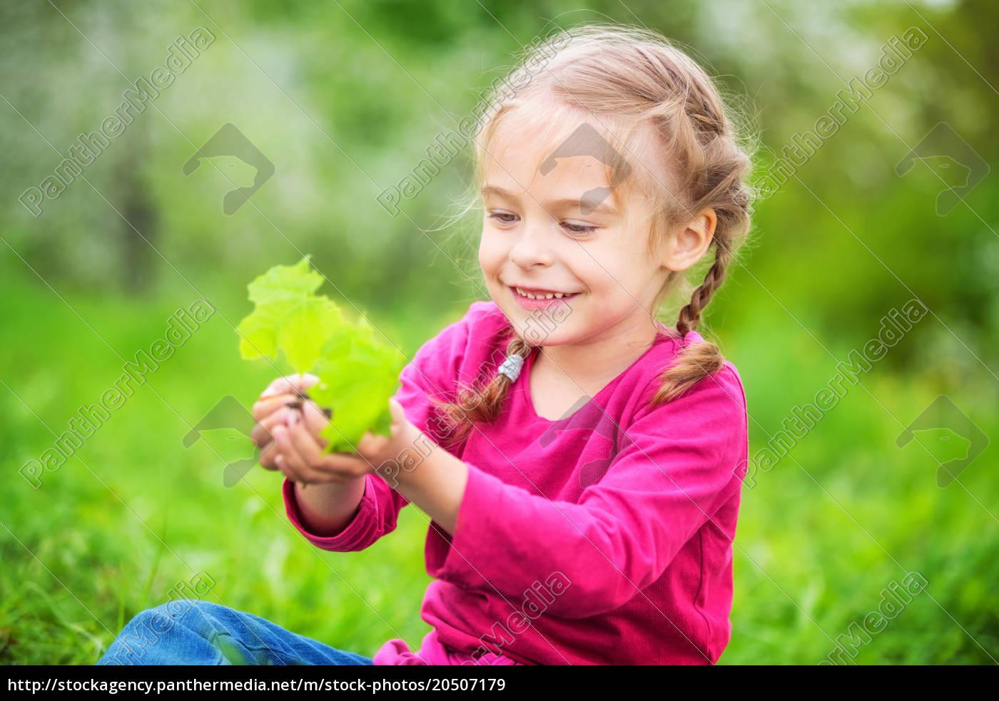 little, girl, holding, little, green, plant - 20507179