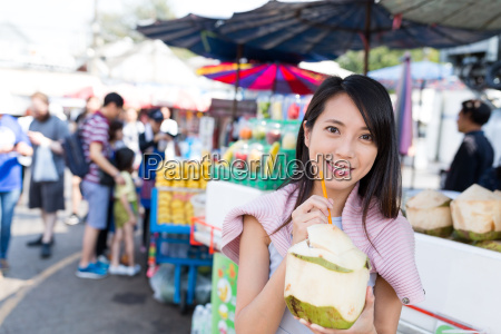 woman, drinking, of, coconut - 20507089