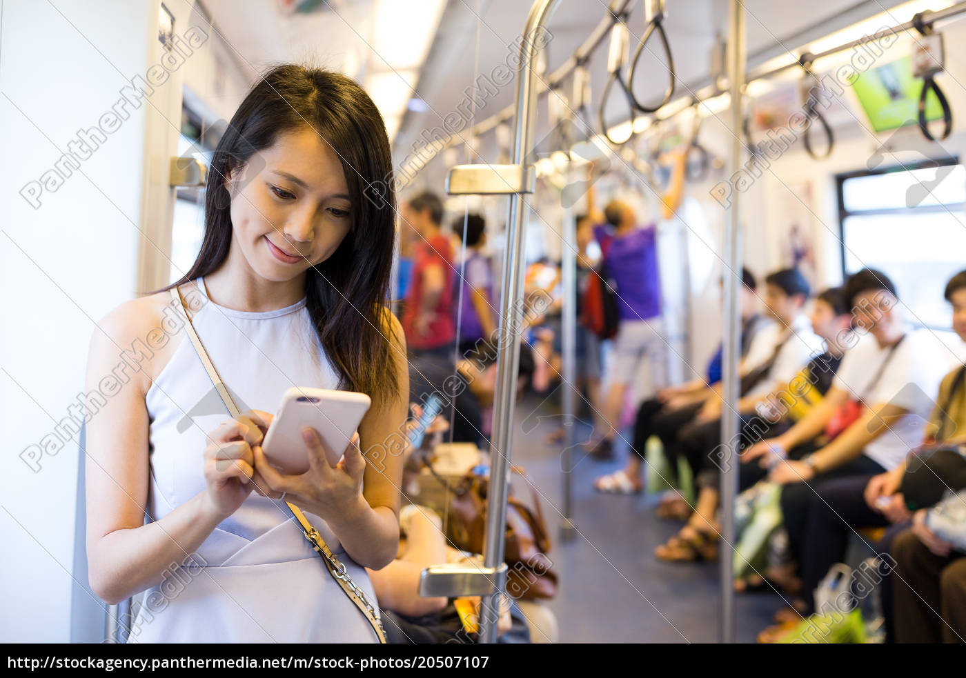 woman, using, cellphone, inside, train, compartment - 20507107