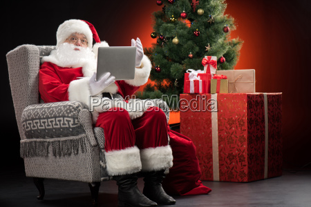 santa claus using laptop and gesturing