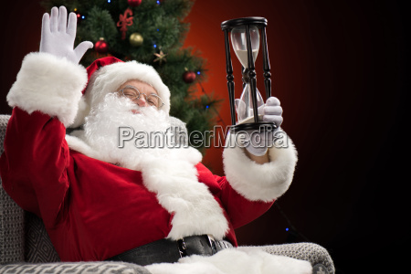 santa claus showing hourglass