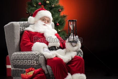 santa claus showing sandwatch