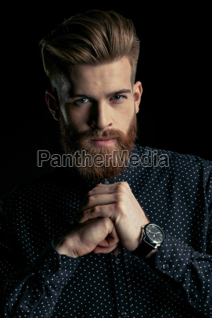 handsome stylish bearded man with wristwatch