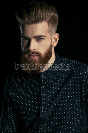 portrait of handsome bearded man in