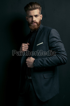 stylish handsome bearded man in trendy