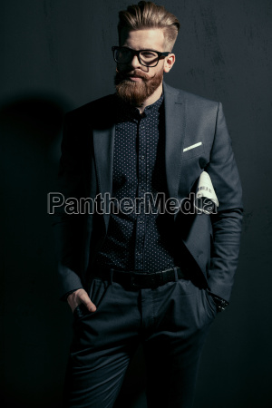 stylish handsome man in trendy suit