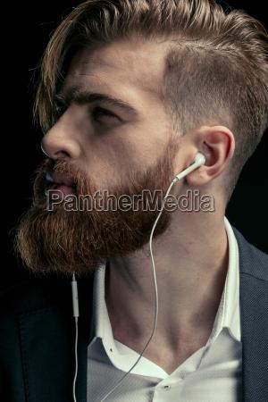 portrait of stylish man listening music