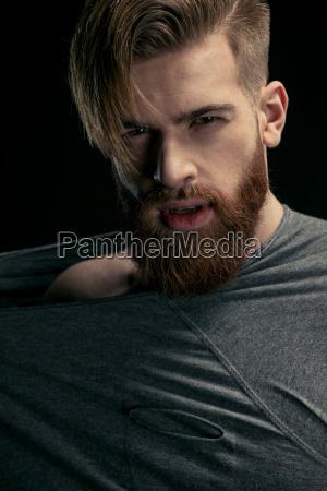 portrait of stylish bearded man on