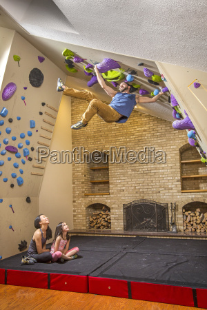 multi ethnic family playing on climbing