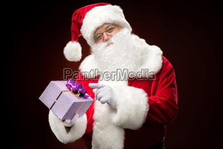 santa, claus, pointing, on, gift, box - 20508255