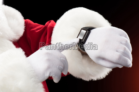 santa, claus, pointing, on, smart-watch - 20508299