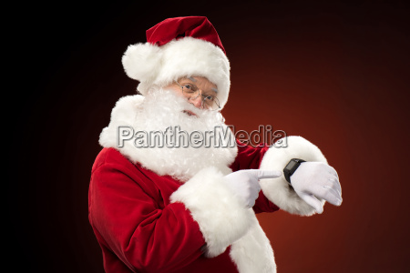 santa, claus, pointing, on, smart-watch - 20508301