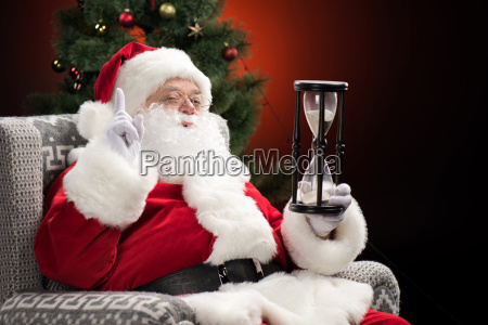 santa, claus, sitting, with, hourglass - 20508475