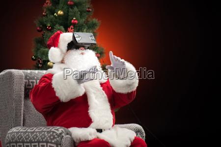 santa, claus, wearing, virtual, reality, headset - 20508499