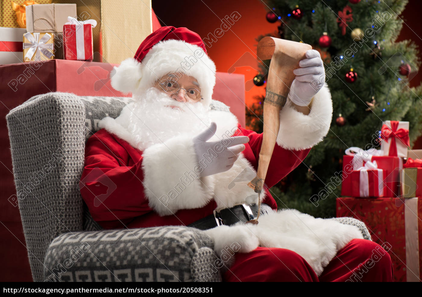 santa, claus, with, wishlist, in, hands - 20508351