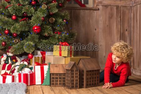 little kid near pile of gift