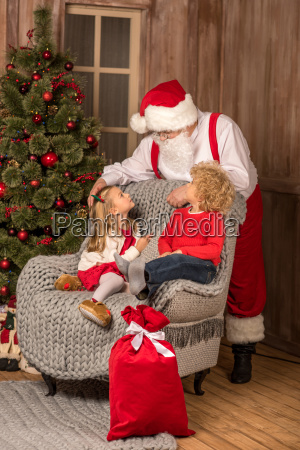 happy children looking at santa claus