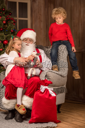 santa claus with happy children
