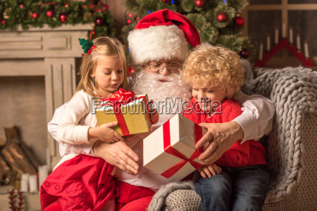 santa claus with children holding gift
