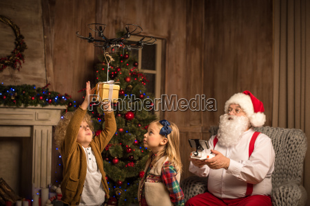 santa claus with children using hexacopter