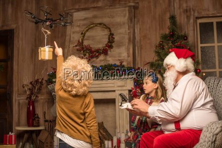 santa, claus, with, children, using, hexacopter - 20509955