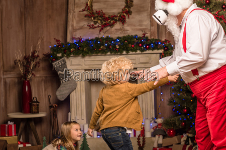 santa claus playing with children