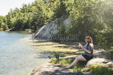 a young woman is calmly reading
