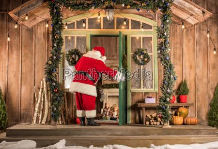 santa claus coming to children at