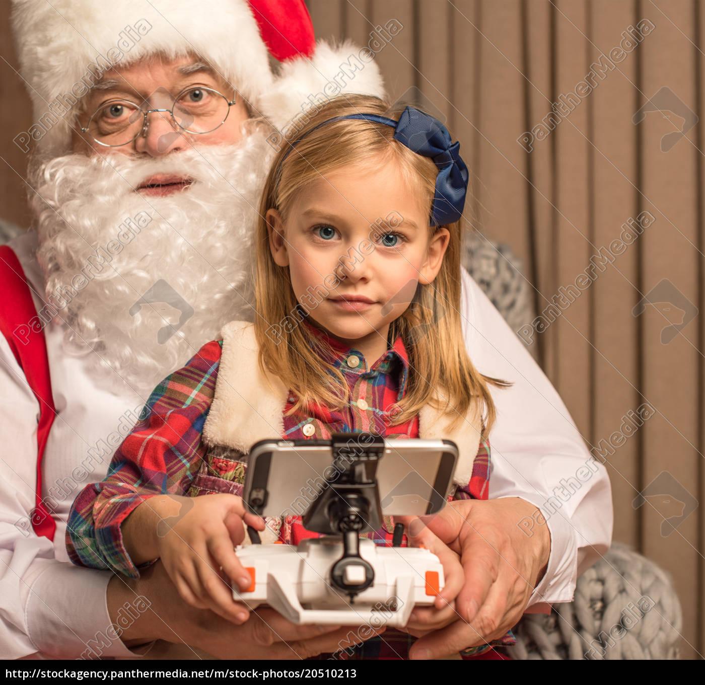 santa, claus, with, kid, looking, at - 20510213