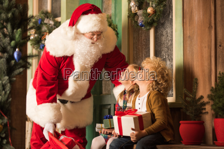 santa claus and children with gift