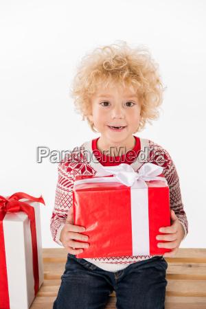 happy child holding gift box