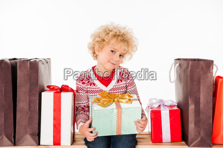 kid with gift boxes and shopping