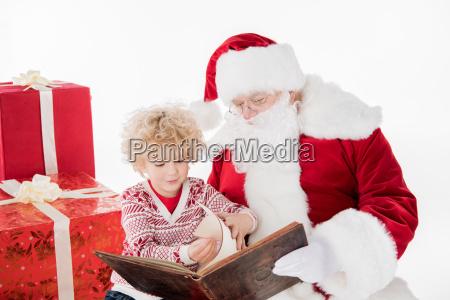 santa claus and kid reading book