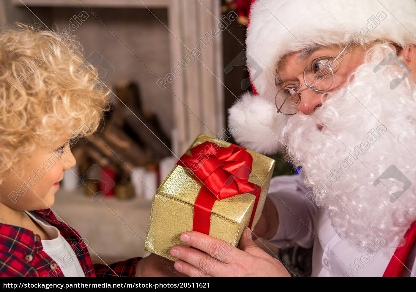 santa, claus, giving, present, to, child - 20511621