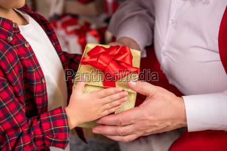 santa, claus, giving, present, to, child - 20511623