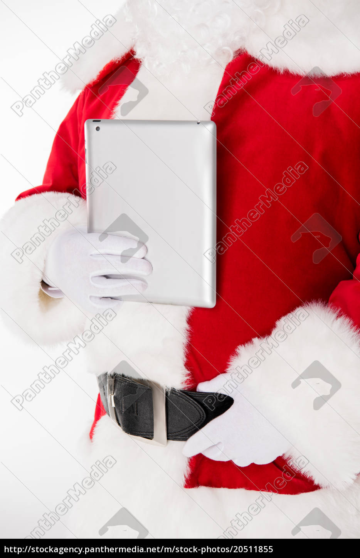 santa, claus, posing, with, digital, tablet - 20511855