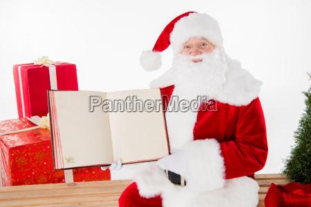 santa, claus, showing, book - 20511907