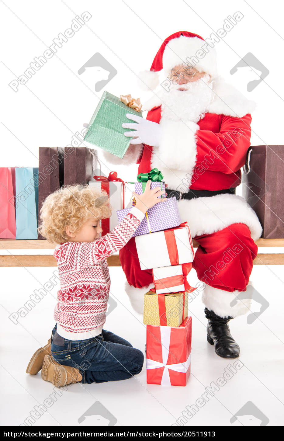 santa, claus, with, child, and, gift - 20511913