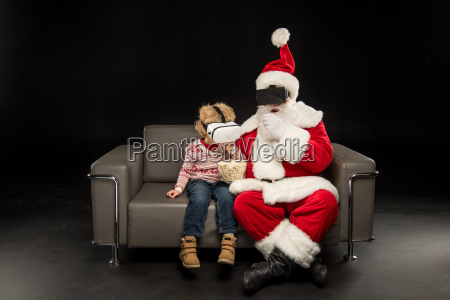 santa claus and child with virtual