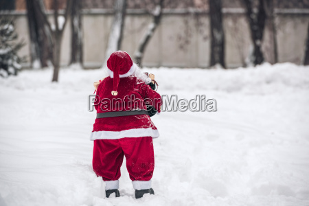 santa claus standing back to camera