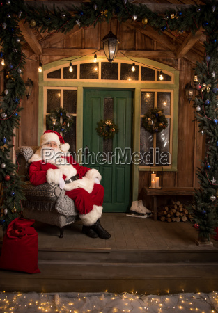 happy, santa, claus, sitting, in, armchair - 20512221