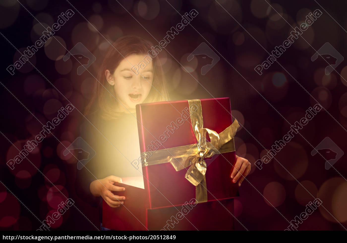 little, girl, opening, a, magic, box - 20512849
