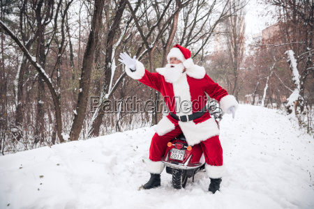 santa, claus, on, scooter, gesturing - 20512583
