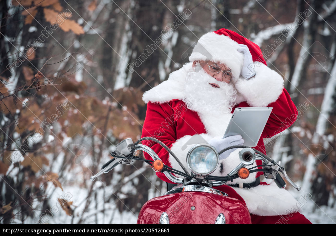 santa, claus, on, scooter, using, tablet - 20512661