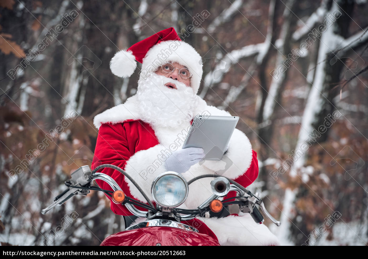 santa, claus, on, scooter, using, tablet - 20512663