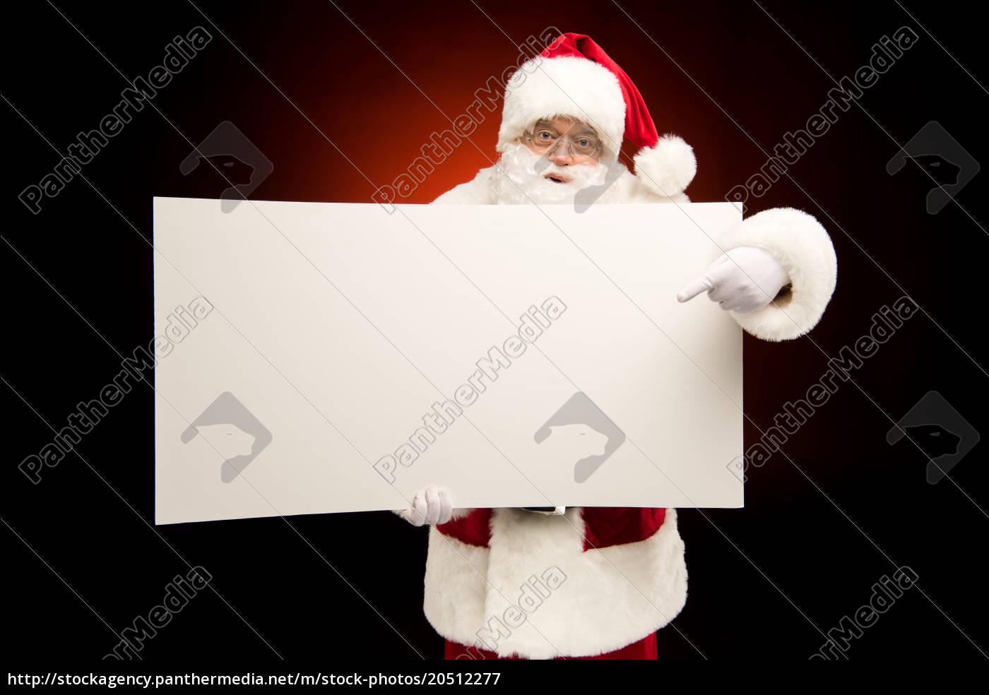 santa, claus, pointing, on, blank, card - 20512277