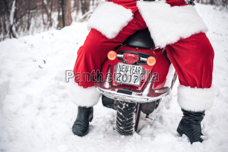 santa, claus, sitting, on, red, scooter - 20512559
