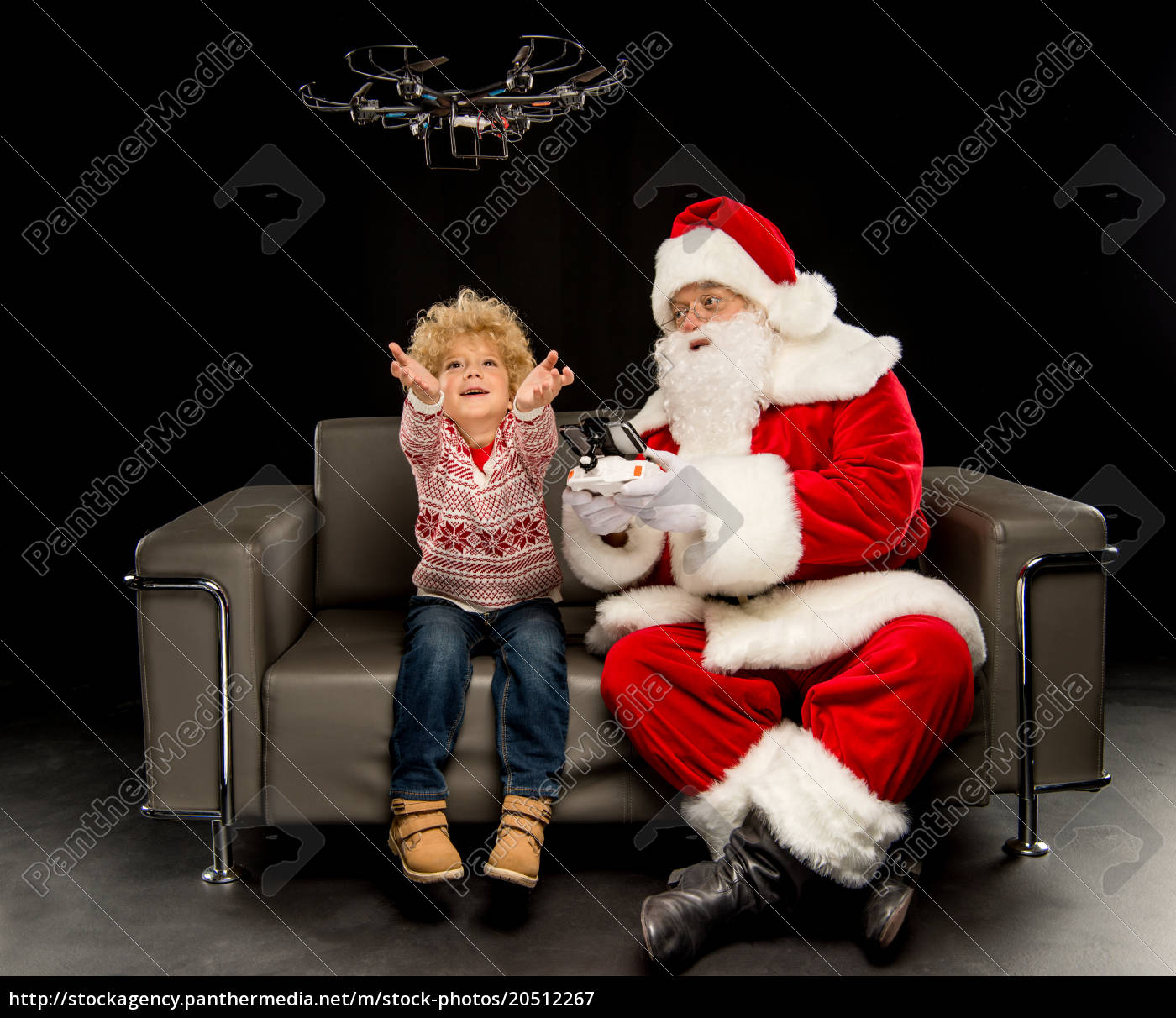 santa, claus, with, child, using, hexacopter - 20512267