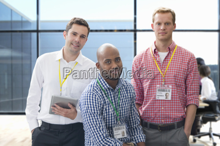 portrait of three casually dressed businessmen
